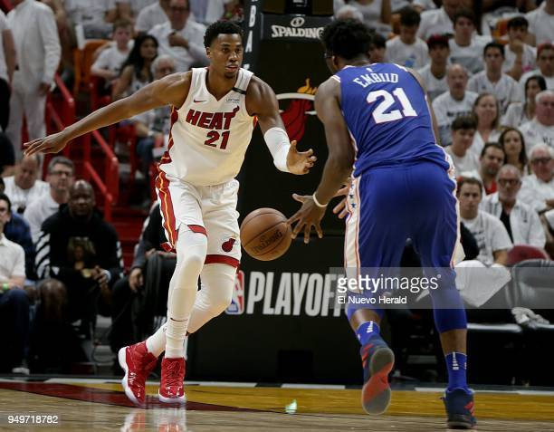The Miami Heat's Hassan Whiteside left defends against the Philadelphia 76ers' Joel Embiid as he drives to the basket in the second quarter in Game 4...