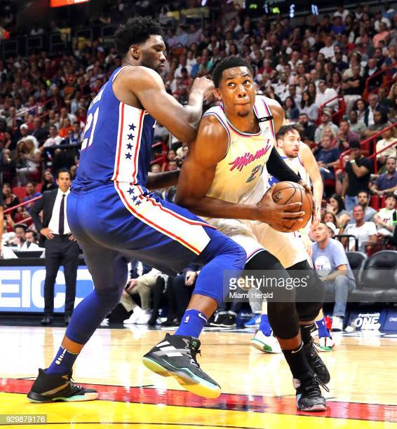 The Miami Heat's Hassan Whiteside right looks to the basket as the Philadelphia 76ers' Joel Embiid defends in the second quarter at the...