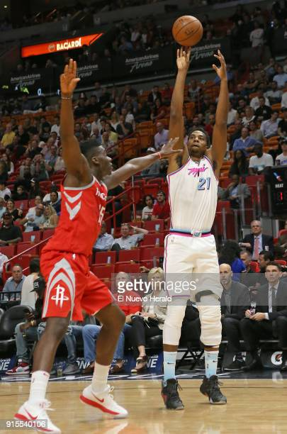 The Miami Heat's Hassan Whiteside right shoots over the Houston Rockets' Clint Capela during the first quarter at the AmericanAirlines Arena in Miami...
