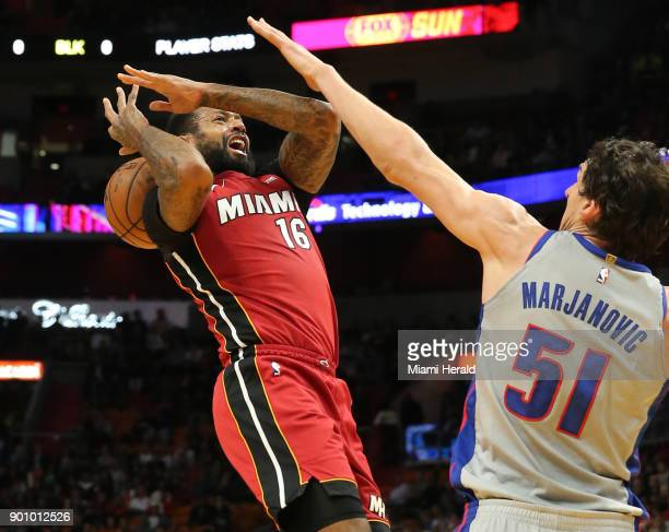 The Miami Heat's James Johnson has his shot blocked by the Detroit Pistons' Boban Marjanovic in the first quarter at the AmericanAirlines Arena in...