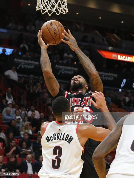 The Miami Heat's James Johnson makes a basket in the final seconds of the second quarter over the Portland Trail Blazers' CJ McCollum at the...