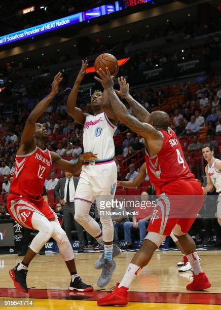 The Miami Heat's Josh Richardson goes to the basket between the Houston Rockets' Luc Mbah a Moute and PJ Tucker during the first quarter at the...