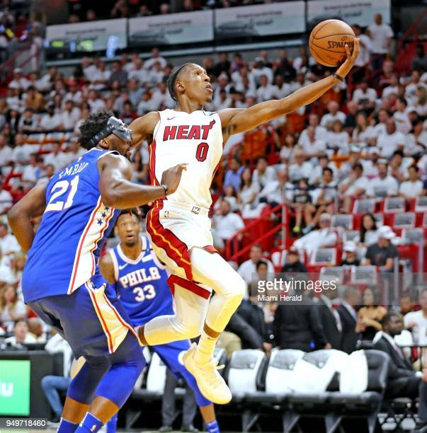 The Miami Heat's Josh Richardson leaps past the Philadelphia 76ers' Joel Embiid for a basket in the first quarter in Game 4 of the firstround NBA...