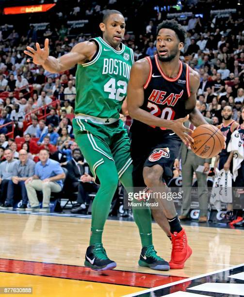 The Miami Heat's Justise Winslow looks to pass around the Boston Celtics' Al Horford at the AmericanAirlines Arena in Miami on Wednesday Nov 22 2017...