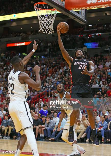 The Miami Heat's Justise Winslow right goes to the basket against the Brooklyn Nets' Caris LeVert during the first quarter at the AmericanAirlines...