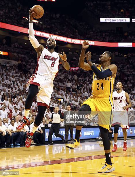 The Miami Heat's LeBron James drives around Indiana Pacers' Lance Stephenson as he scores a basket in the first quarter during Game 6 of the Eastern...