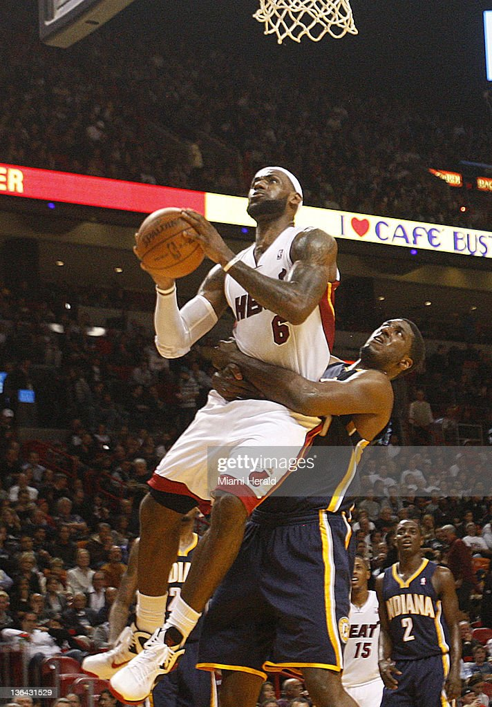 6114c1e40327 The Miami Heat s LeBron James gets a lift from Roy Hibbert of the ...