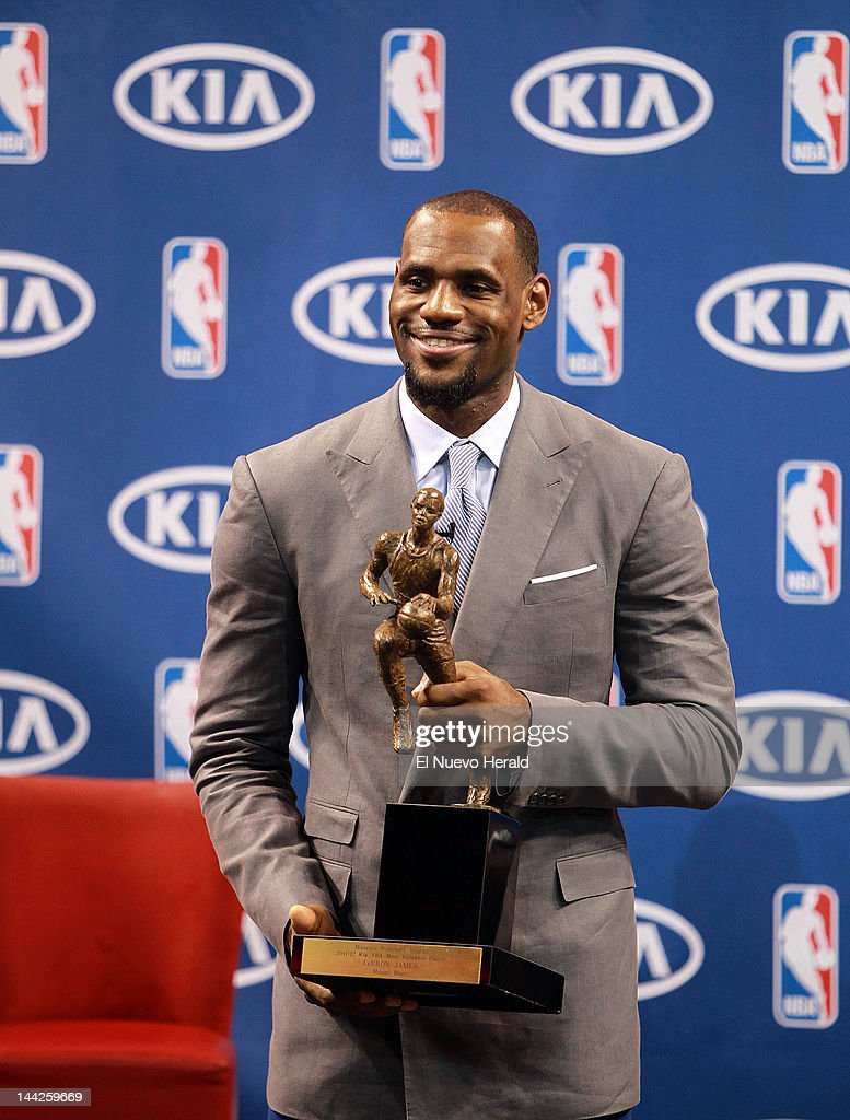 The Miami Heats Lebron James Holds NBA Most Valuable Player Trophy During A Press Conference