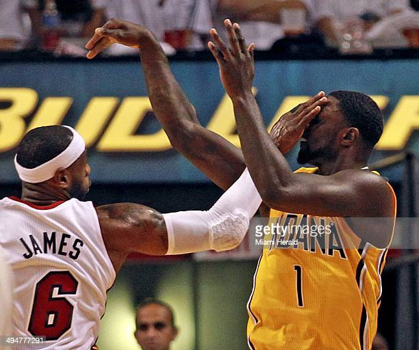 The Miami Heat's LeBron James slaps the Indiana Pacers' Lance Stephenson in the face after he shoots the ball in the first quarter during Game 6 of...