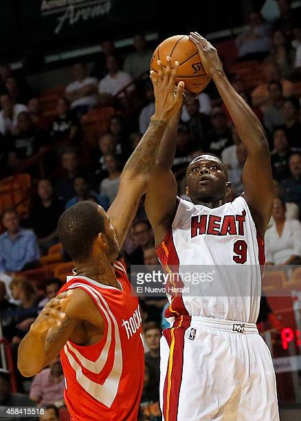 The Miami Heat's Luol Deng shoots over the Houston Rockets' Trevor Ariza in the first quarter at AmericanAirlines Arena in Miami on Tuesday Nov 4...