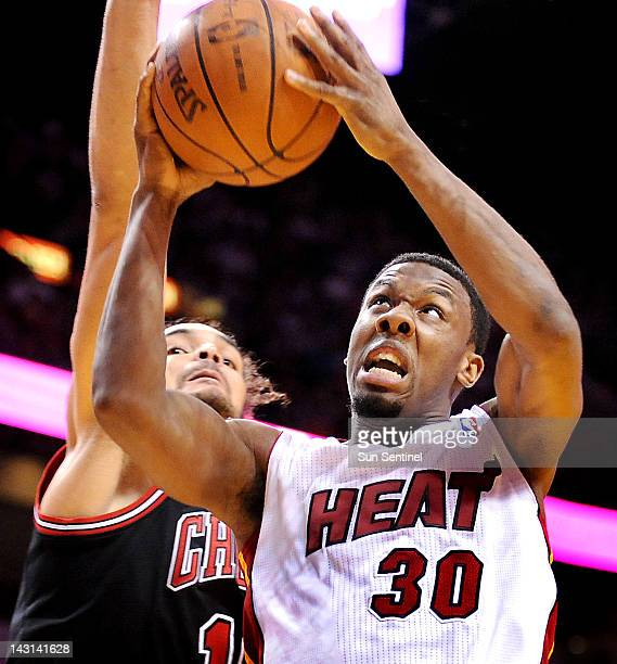 The Miami Heat's Norris Cole goes hard to the basket as the Chicago Bulls' Joakim Noah defends at the AmericanAirlines Arena in Miami Florida on...