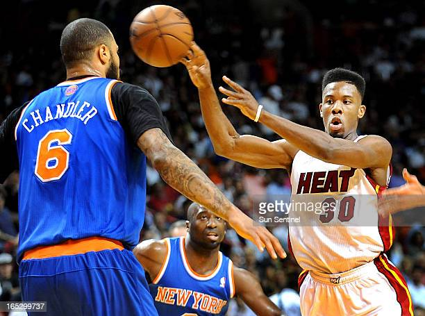 The Miami Heat's Norris Cole makes the nolook pass while being against the New York Knicks' Tyson Chandler at AmericanAirlines Arena in Miami Florida...