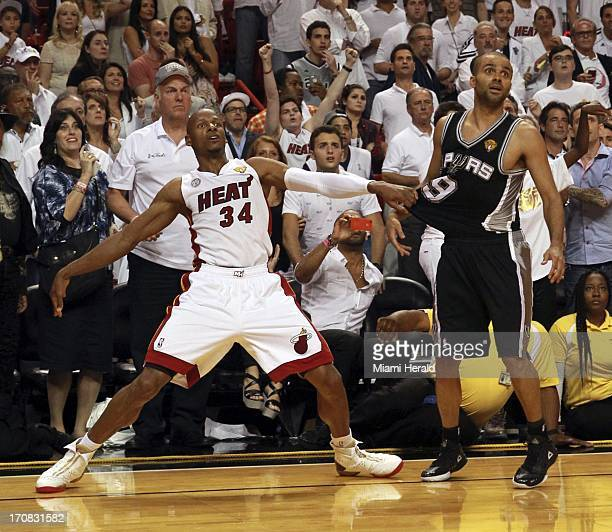 The Miami Heat's Ray Allen watches his 3pointer fall in the final seconds of the fourth quarter as he holds the San Antonio Spurs' Tony Parker in...