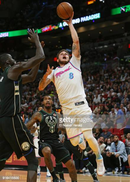 The Miami Heat's Tyler Johnson goes to the basket against the Milwaukee Bucks' Thon Maker during the second quarter at the AmericanAirlines Arena in...