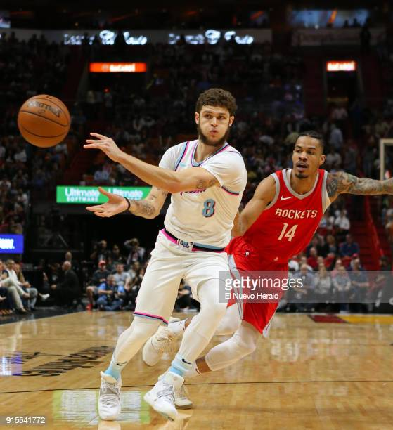 The Miami Heat's Tyler Johnson passes the ball away from the Houston Rockets' Gerald Green right during the first quarter at the AmericanAirlines...