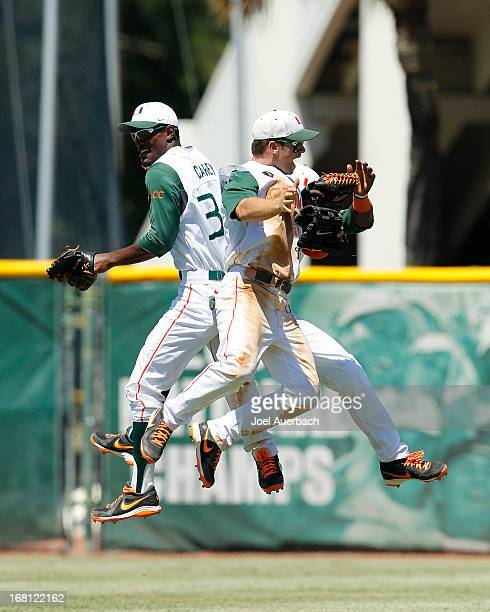 The Miami Hurricanes celebrate their victory against the St John's Red Storm on May 5 2013 at Alex Rodriguez Park at Mark Light Field in Coral Gables...