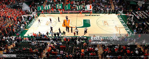 The Miami Hurricanes cheerleaders lead the team onto the court for their game against the Duke Blue Devils on January 23 2013 at the BankUnited...