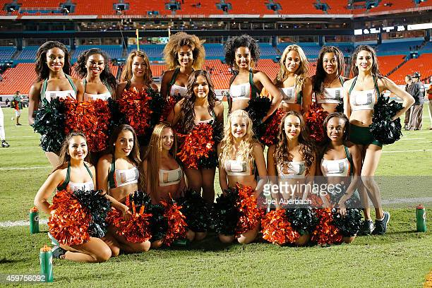 The Miami Hurricanes cheerleaders pose for a photo after the game against the Pittsburgh Panthers on November 29 2014 at Sun Life Stadium in Miami...