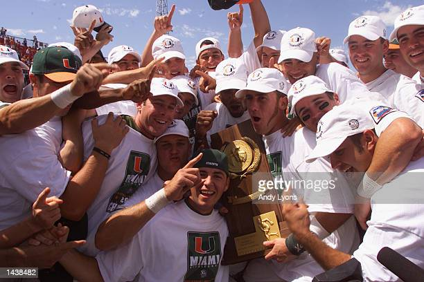 The Miami Hurricanes hold up the NCAA trophy after their win over the Stanford Cardinal during the Finals of the College World Series on June 16,...
