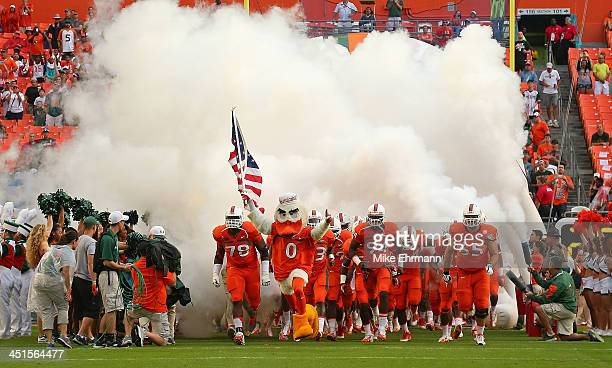The Miami Hurricanes take the field during a game against the Virginia Cavaliers at Sun Life Stadium on November 23 2013 in Miami Gardens Florida