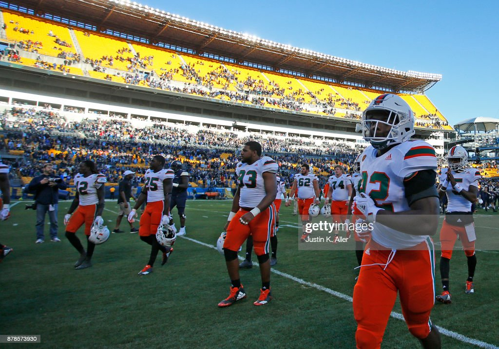 The Miami Hurricanes walk off the field after being upset 24-14 against the Pittsburgh Panthers on November 24, 2017 at Heinz Field in Pittsburgh, Pennsylvania.