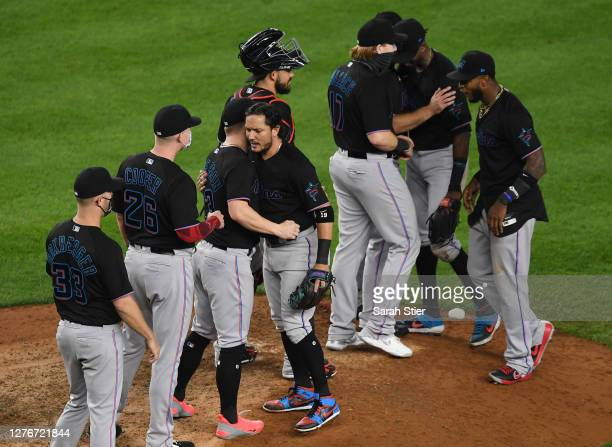 The Miami Marlins celebrate during the tenth inning against the New York Yankees at Yankee Stadium on September 25, 2020 in the Bronx borough of New...