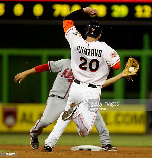 The Miami Marlins' Justin Ruggiano retired at second base by Atlanta Braves shortstop Andrelton Simmons in the fourth inning at Marlins Park in Miami...
