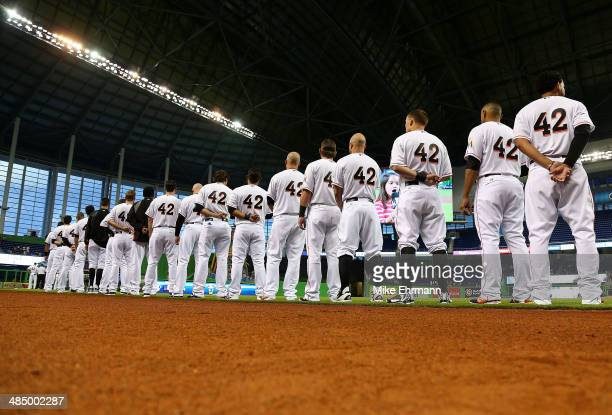 The Miami Marlins line up during a game against the Washington Nationals at Marlins Park on April 15 2014 in Miami Florida All uniformed team members...