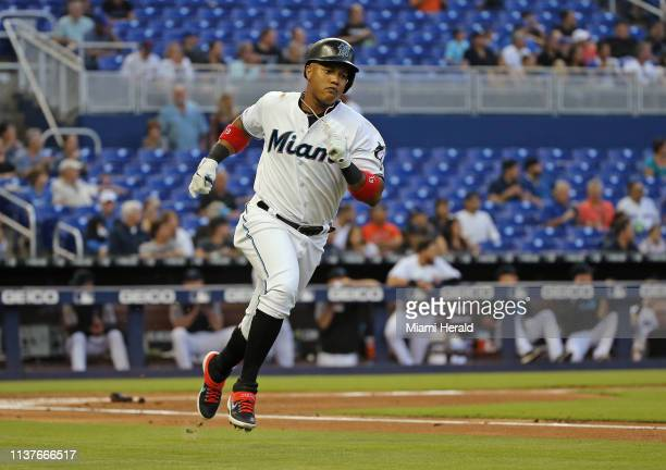 The Miami Marlins' Starlin Castro runs to first base after hitting a single during the first inning against the Chicago Cubs at Marlins Park in Miami...