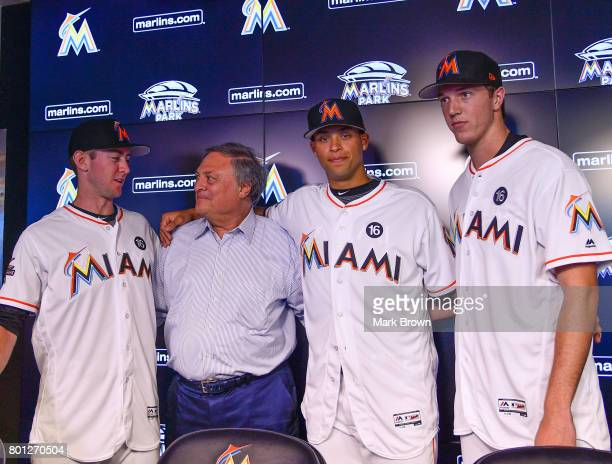 The Miami Marlins top three draft picks Brian Miller Joe Dunand and Trevor Rogers with Miami Marlins owner Jeffrey Loria visit Marlins Park for a...