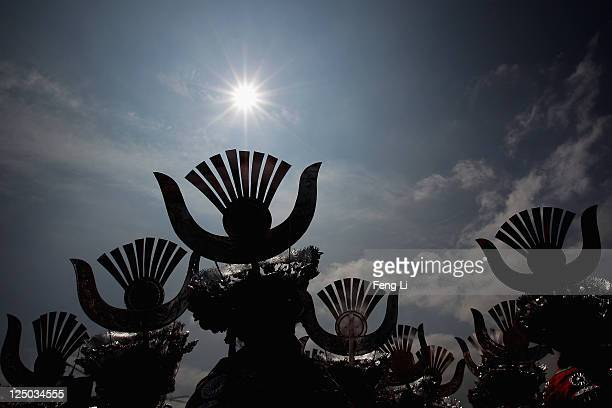 The Miao ethnic minority dancers perform during the large party of the 9th National Traditional Games of Ethnic Minorities of the People's Republic...