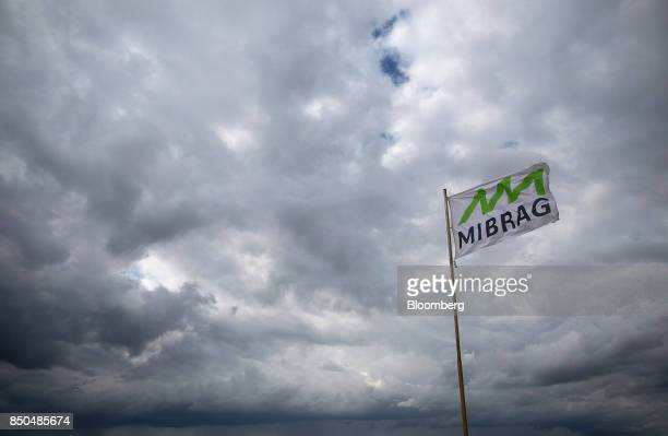 The Mibrag GmbH logo sits on a flag flying on a public viewing platform at Mibrag's Schleenhain open cast lignite mine near the village of Poedelwitz...