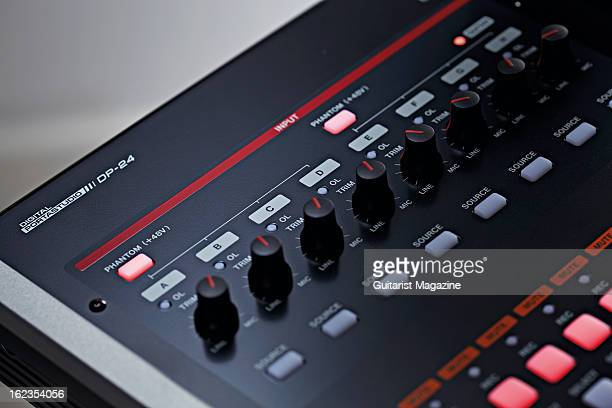 The mic and line controls of a Tascam DP24 portable digital multitrack recorder photographed during a studio shoot for Guitarist Magazine July 20 2012
