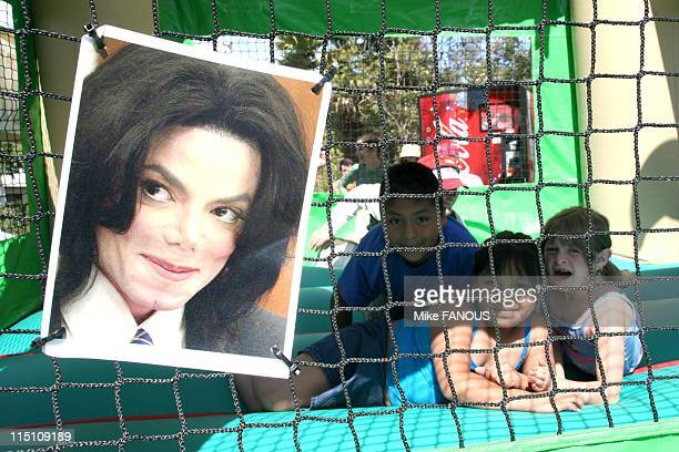The Michael Jackson Trial Continues in Santa Maria United States on June 08 2005 Little kids play inside an inflatable jump house with pictures of...