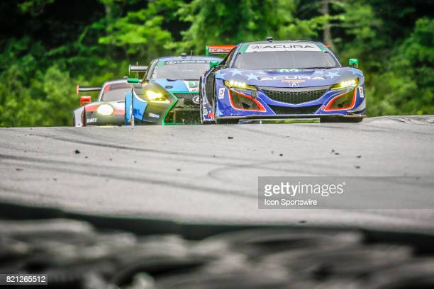 The Michael Shank Racing Acura NSX GT3 driven by Andy Lally and Katherine Legge leads pack over Uphill section during the IMSA WeatherTech SportsCar...