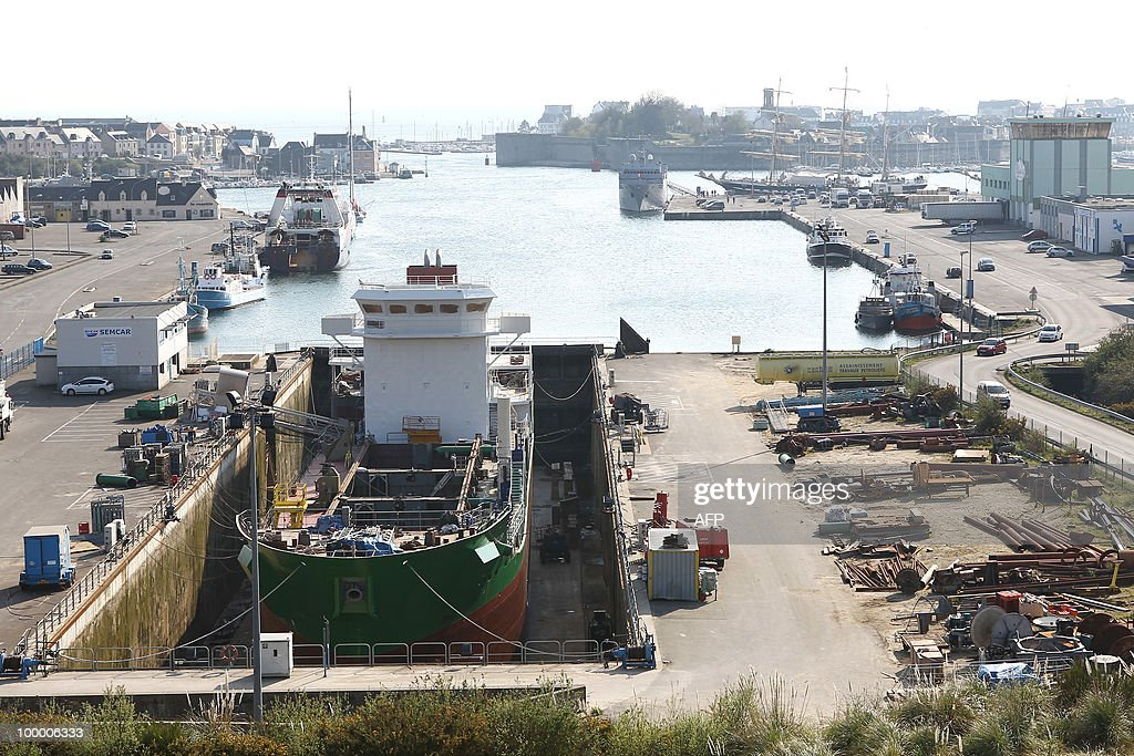 CLAUDE The 'Michel DSR', a sand dredger is into a Piriou' shipyards drylock in Concarneau, western France, on April 16, 2010. While French shipbuilding faces economic turmoil, Piriou' small company succeeds in business by establishing sites overseas in Vietnam, Nigeria or Mauritius.
