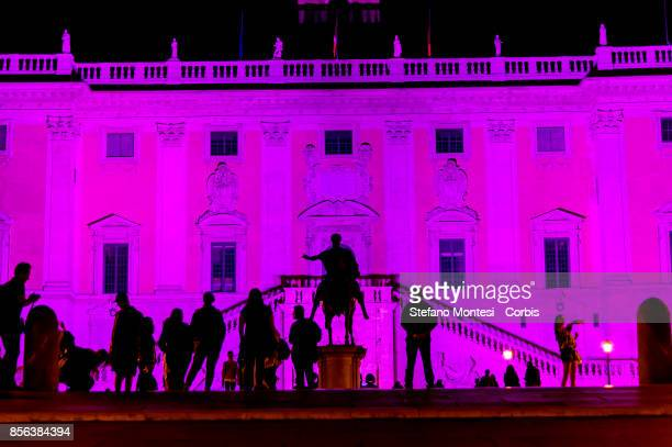 The Michelangelo façade of Palazzo Senatorio in Campidoglio illuminated with pink a colour that has been a symbol of the fight against breast cancer...