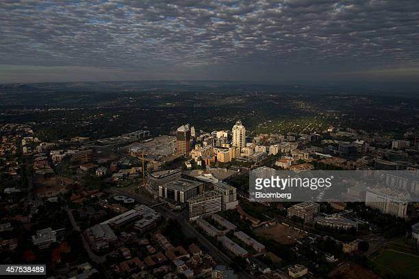 The Michelangelo Hotel, center, stands illuminated by sunlight in the Sandton City central business district in Johannesburg, South Africa, on...