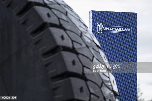 The Michelin Cie Bibendum mascot also known as the Michelin Man sits on a sign outside the new Michelin research and development campus near...