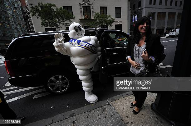 The Michelin Man gets into a limousine after walking with fellow advertising mascots as he was being inducted in the New York Advertising Week's Walk...