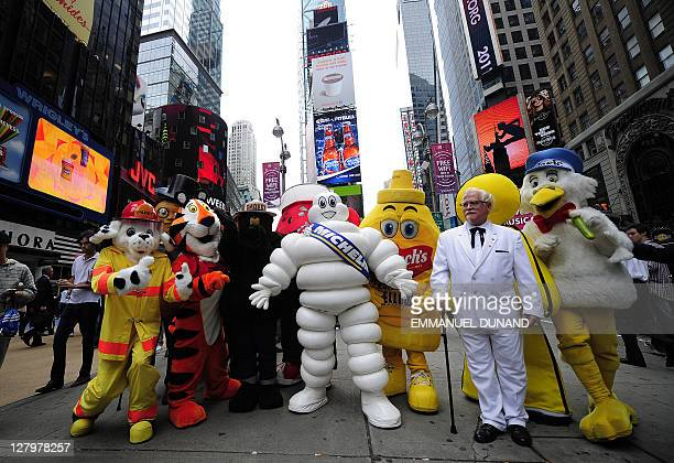 The Michelin Man poses with other advertising mascots after being inducted in the New York Advertising Week's Walk of Fame as its Icon of the Year on...