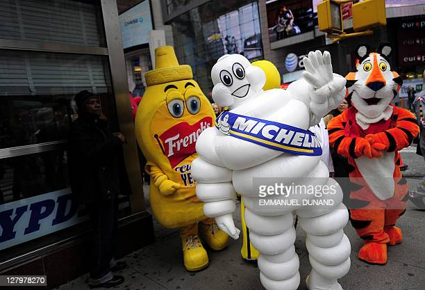 The Michelin Man walks with other advertising mascots after being inducted in the New York Advertising Week's Walk of Fame as its Icon of the Year on...
