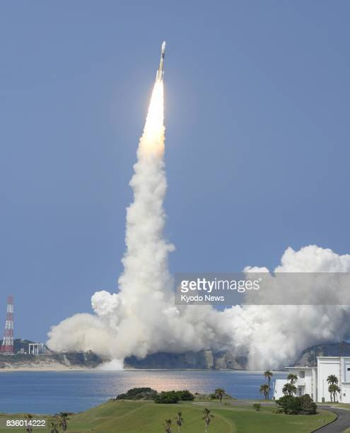 The Michibiki No 3 satellite the third of Japan's new quasizenith satellites is launched on an H2A rocket from the Tanegashima Space Center in...