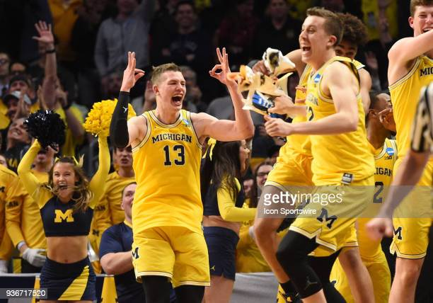 The Michigan bench and F Moritz Wagner of the Michigan Wolverines erupt in excitement after a three pointer was scored towards the end of the game...