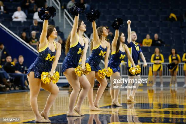 The Michigan dance team performs during a timeout during a regular season Big 10 Conference basketball game between the Northwestern Wildcats and the...