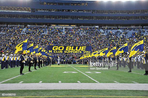 The Michigan Marching Band and M Club form the tunnel for the team to take the field prior to the NCAA football game between the Indiana Hoosiers and...