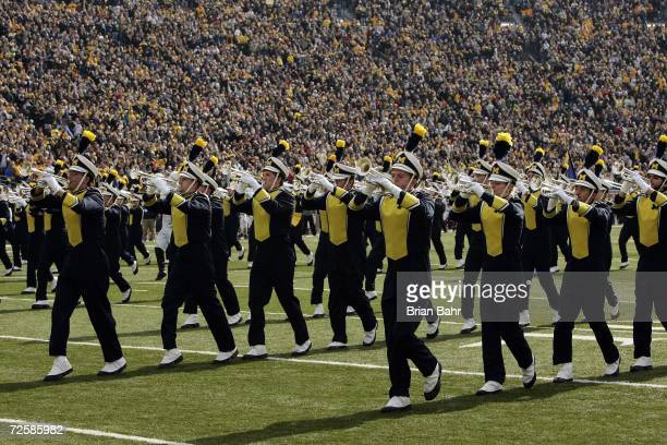 The Michigan Marching Band performs during the NCAA football game between the Ball State Cardinals and the Michigan Wolverines on November 4 2006 at...