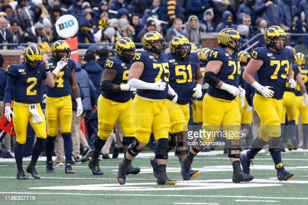 The Michigan offensive line heads onto the field after a kickoff return during a regular season Big 10 Conference game between the Ohio State...