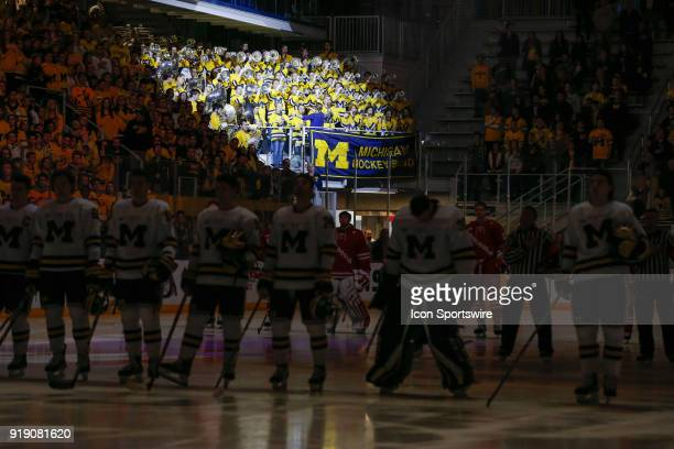 The Michigan pep band is highlighted by a spotlight during the playing of the National Anthem during a regular season Big 10 Conference hockey game...