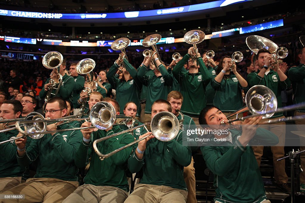 The MIchigan State band in action during the Virginia Cavaliers Vs Michigan State Spartans basketball game during the 2014 NCAA Division 1 Men's Basketball Championship, East Regional at Madison Square Garden, New York, USA. 28th March 2014. Photo Tim Clayton